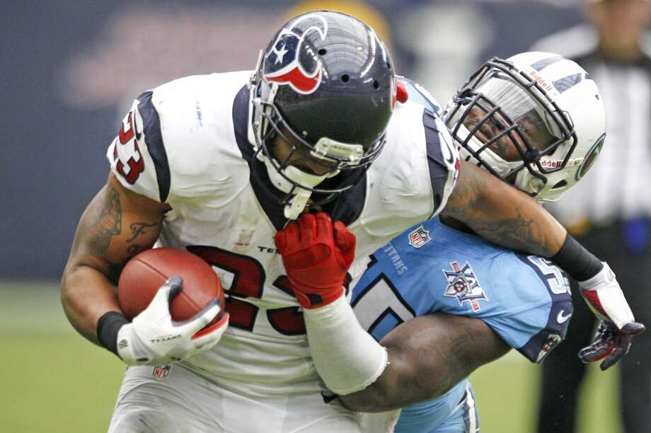 Texans running back Arian Foster is caught from behind by Titans outside linebacker Zach Brown during overtime. Photo: Brett Coomer, Houston Chronicle