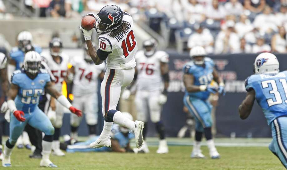 Texans wide receiver DeAndre Hopkins makes a catch against Titans strong safety Bernard Pollard . Photo: Brett Coomer, Houston Chronicle
