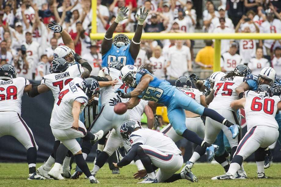 Titans free safety Michael Griffin (33) blocks a field goal attempt  by Texans kicker Randy Bullock (4) at the end of regulation. The play was overturned due to a penalty against the Titans. Photo: Smiley N. Pool, Houston Chronicle