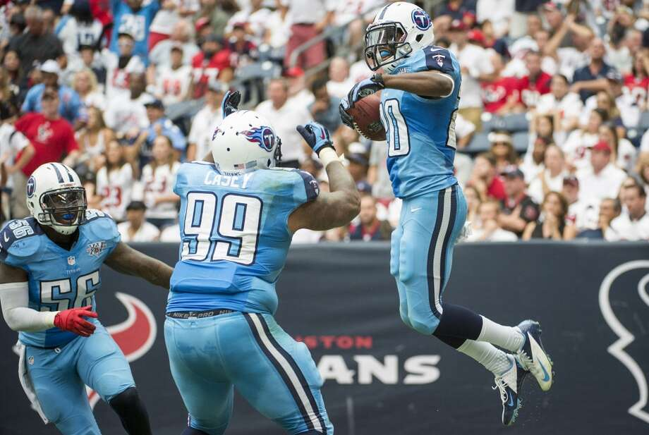 Titans cornerback Alterraun Verner celebrates with defensive tackle Jurrell Casey (99) after intercepting a pass and returning it for a touchdown. Photo: Smiley N. Pool, Houston Chronicle