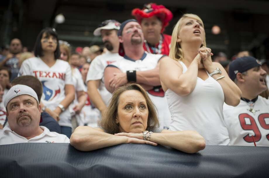 Nervous Texans fans watch their team  during overtime. Photo: Smiley N. Pool, Houston Chronicle