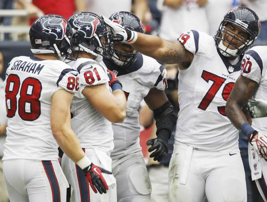 Texans tight end Garrett Graham (88), tight end Owen Daniels (81) and guard Brandon Brooks (79) celebrate Daniels' 12-yard touchdown reception during the third quarter. Photo: Brett Coomer, Houston Chronicle