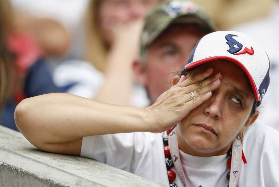 Texans fan Julia Vandiver reacts to a Titans touchdown during the fourth quarter. Photo: Karen Warren, Houston Chronicle