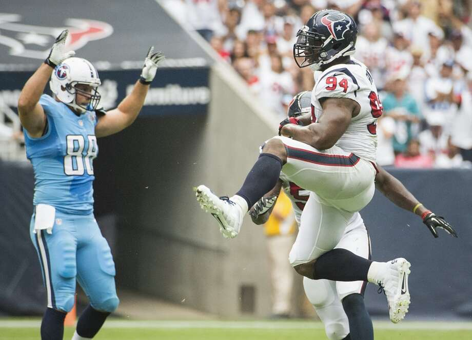 Texans defensive end Antonio Smith celebrates a defensive stop on a Titans fourth down try during the first half. Photo: Smiley N. Pool, Houston Chronicle