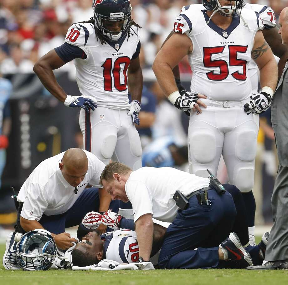 Texans wide receiver Andre Johnson receives attention after being shaken up during the first quarter. Photo: Karen Warren, Houston Chronicle