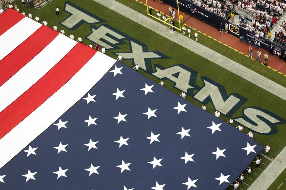 A giant American flag is displayed before the Texans home opener against the Tennessee Titans. Photo: Houston Chronicle