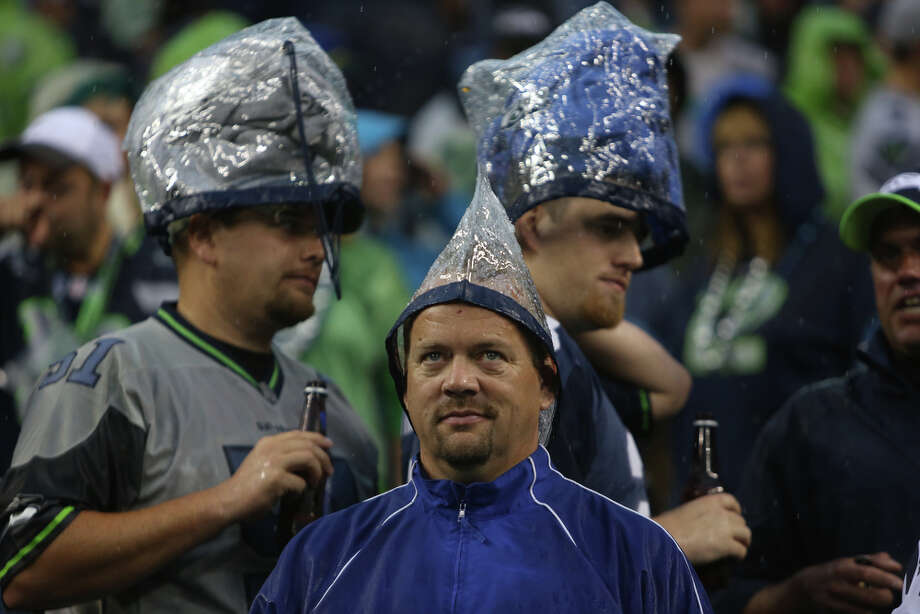 Seahawks fans put their NFL-approved plastic bags to good use during a weather delay Sunday during the Seahawks-49ers game in Seattle. Photo: Joshua Trujillo, Seattlepi.com / SEATTLEPI.COM