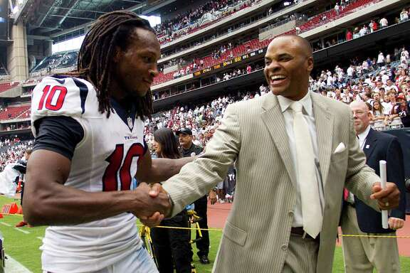 Rookie wide receiver DeAndre Hopkins earns a handshake and a compliment from the boss, general manager Rick Smith, after sealing the Texans' 30-24 overtime win against the Titans with his 3-yard touchdown reception.