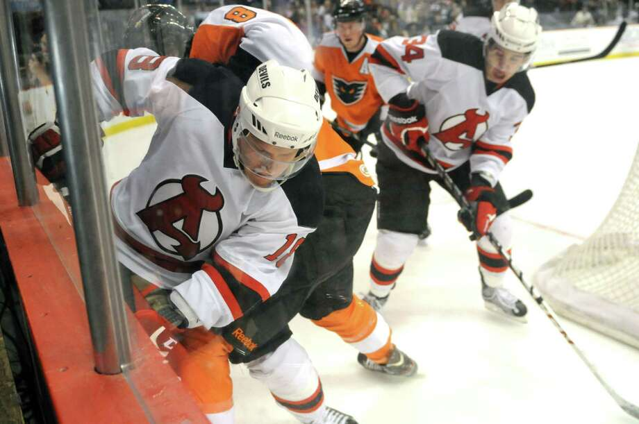 Albany Devils? Harri Pesonen, left, fights for the puck with  Rob Bordson of the Adirondack Phantoms, #8, Sunday evening April 21, 2013, at the Times Union Center in Albany, N.Y. (Will Waldron/Times Union) Photo: Will Waldron / 00021748J