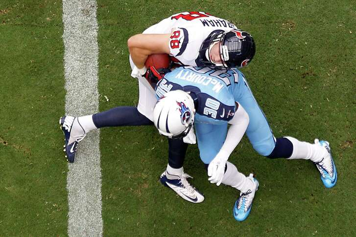 Despite the efforts of Titans cornerback Jason McCourty (30), tight end Garrett Graham (88) puts the first points on the scoreboard for the Texans with a 1-yard pass from Matt Schaub in the first quarter. Graham finished with three receptions for 30 yards. He also had a TD in the opener.
