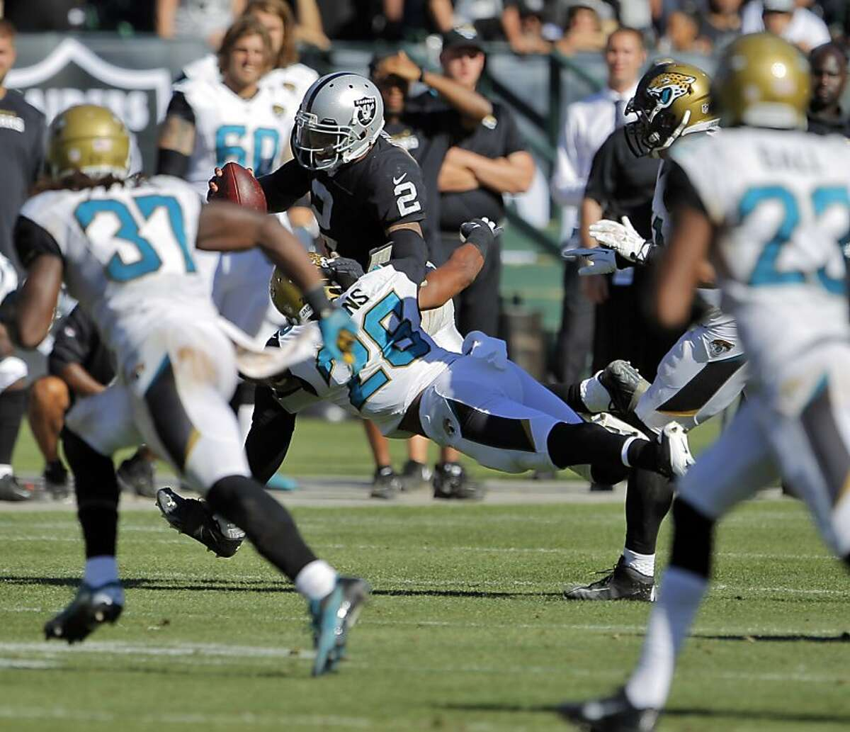 Terrelle Pryor runs the ball in the fourth quarter, and for the game had 50 yards on 9 carries. The Oakland Raiders played the Jacksonville Jaguars at O.co Coliseum in Oakland, Calif., on Sunday, September 15, 2013.