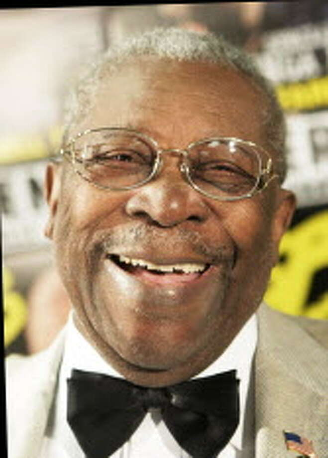 **FILE** Blues singer B.B. King smiles during a media conference before the first concert of his current farewell tour, in Berlin, in a Thursday, Sept. 7, 2006 file photo. King is the new owner of a juke joint in his Mississippi Delta hometown OF Indianola, Miss.  (AP Photo/ Jan Bauer, File) Photo: JAN BAUER / AP