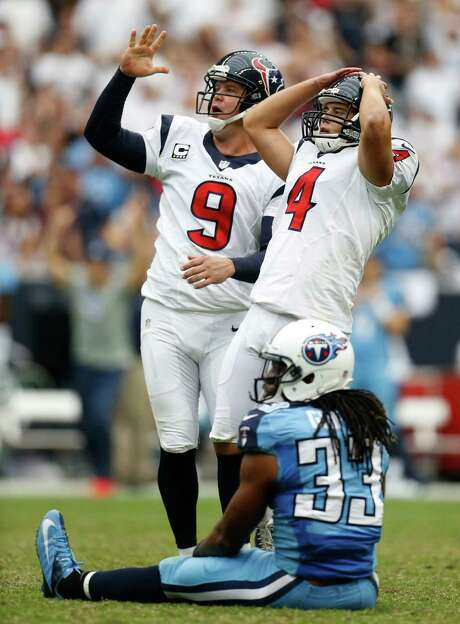 The dismay is evident for Texans kicker Randy Bullock (4) and punter/holder Shane Lechler (9) as Bullock's field -goal attempt of 46 yards at the end of regulation misses its mark, sending the game at Reliant Stadium into overtime. The Texans beat the Titans 30-24 to move to 2-0. Photo: Karen Warren, Staff / © 2013 Houston Chronicle