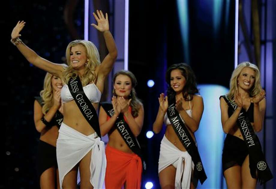 Miss Georgia Carly Mathis acknowledges the crowd after advancing beyond the lifestyle competition. Photo: Mel Evans, AP / AP