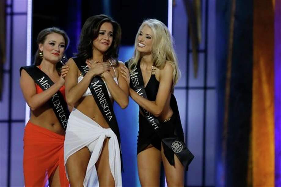 Miss Minnesota Rebecca Yeh, center, is congratulated by Miss Kentucky Jenna Day, left, and Miss Mississippi Chelsea Rick after Yeh advanced beyond the lifestyle competition. Photo: Mel Evans, AP / AP