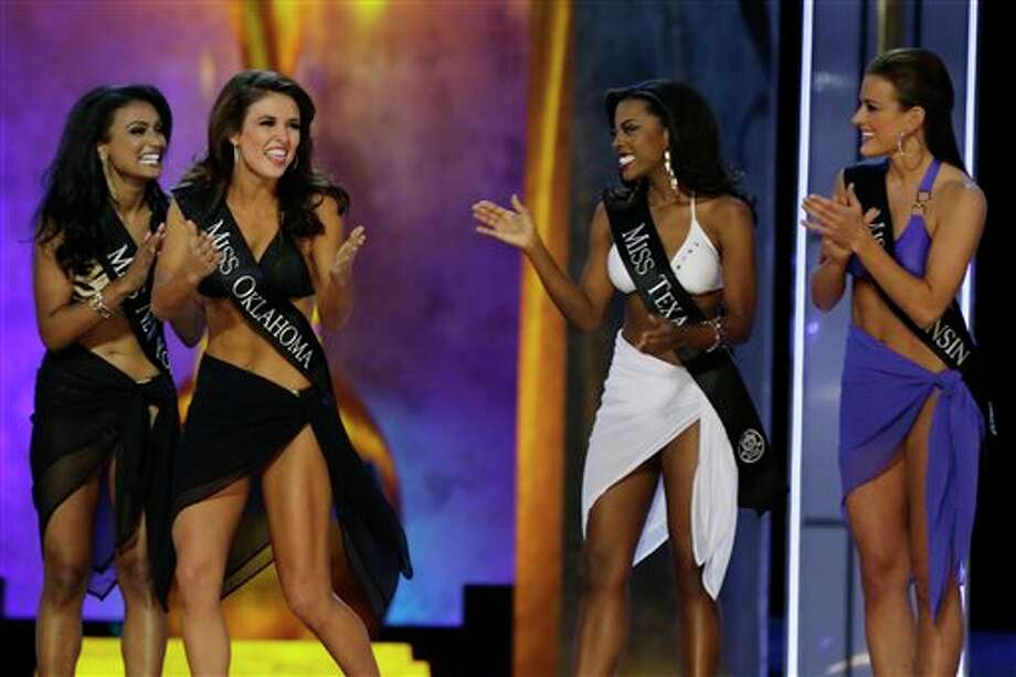 Miss Oklahoma Kelsey Griswold, center, reacts after finding out she's advancing beyond the lifestyle competition. Photo: Mel Evans, AP / AP
