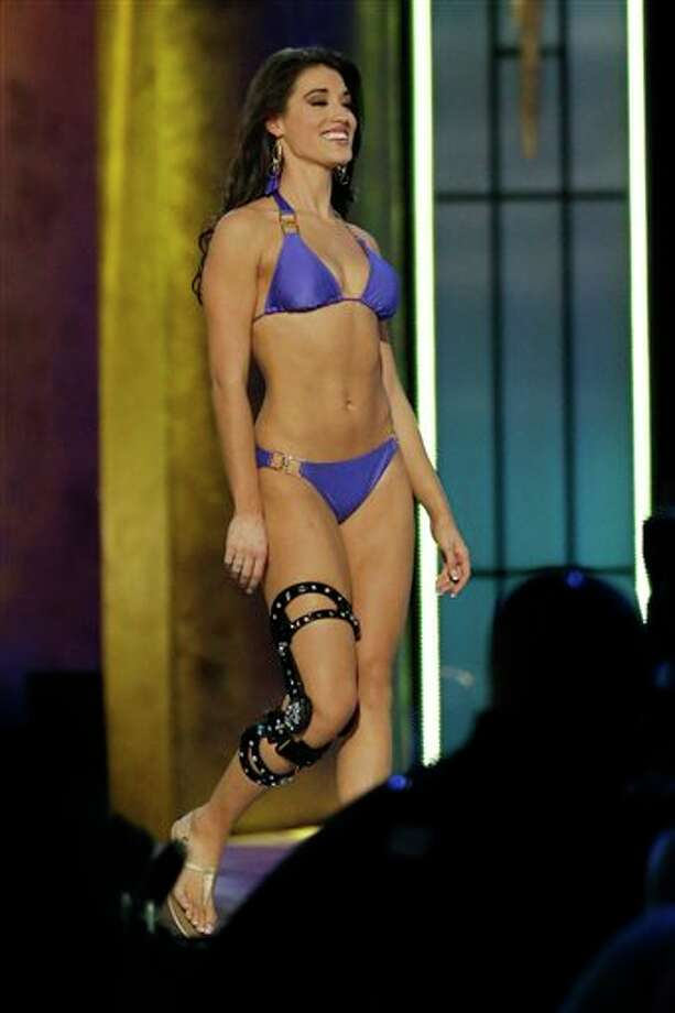 Miss Florida Myrrhanda Jones displays her swimsuit during the Miss America 2014 pageant, Sunday, Sept. 15, 2013, in Atlantic City, N.J. (AP Photo/Julio Cortez) Photo: Julio Cortez, AP / AP