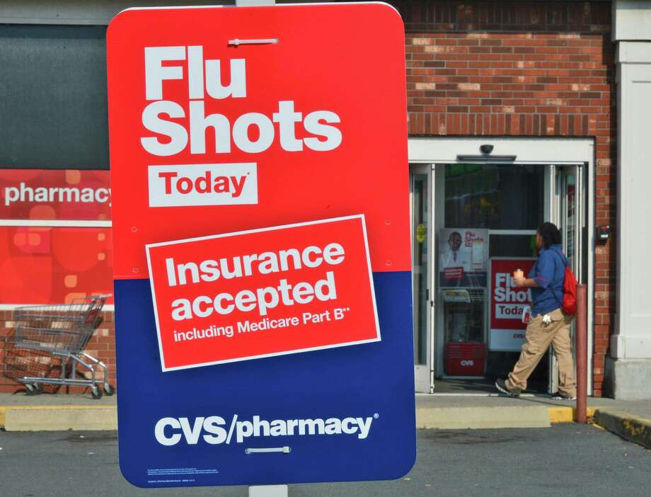 Flu shot sign outside CVS pharmacy on Wolf Rd. Wednesday Sept. 11, 2013, in Colonie, NY.  (John Carl D'Annibale / Times Union) Photo: John Carl D'Annibale / 00023826A