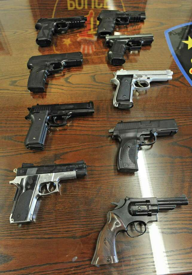 Pellet or BB guns are mixed in with real hand guns at the Troy police headquarters on Wednesday, Sept. 4, 2013 in Troy, N.Y. There have been an increase in these fake guns on the streets and officers can't tell the difference in most situations. (Lori Van Buren / Times Union) Photo: Lori Van Buren / 00023719A