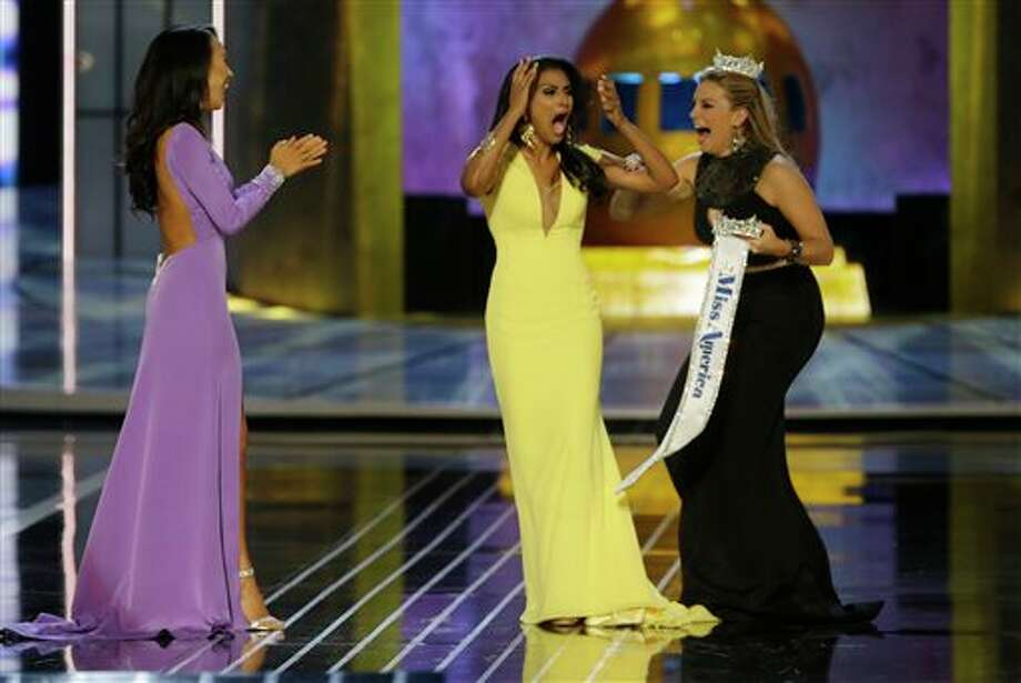 Miss New York Nina Davuluri, center, reacts after being named Miss America 2014 as Miss California Crystal Lee, left, and Miss America 2013 Mallory Hagan celebrate with her on Sunday, Sept. 15. Photo: Mel Evans, AP / AP