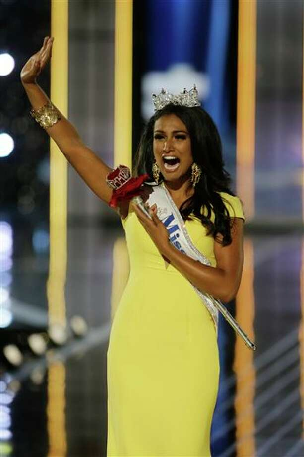 Miss New York Nina Davuluri walks down the runway after winning the the Miss America 2014 pageant. Photo: Mel Evans, AP / AP