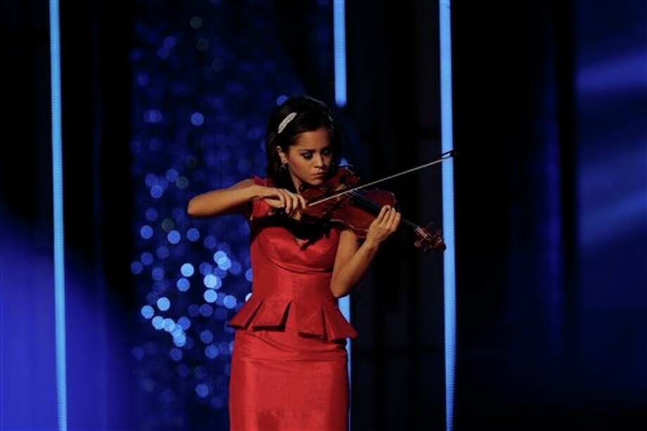 Miss Minnesota Rebecca Yeh performs during the Miss America 2014 pageant. Photo: Mel Evans, AP / AP