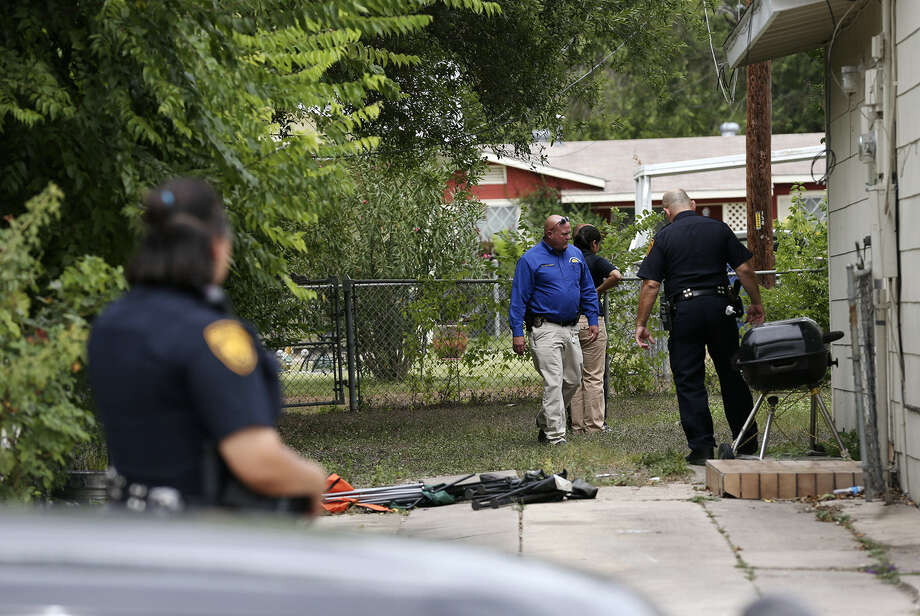 San Antonio Police detectives return Sunday to a murder scene at the 300 block of East Palfrey Steet. Gabriel Martinez, 13, was shot twice as he stood in front of his home at 3 a.m. Sunday. The boy died at the scene. Photo: Jerry Lara / San Antonio Express-News