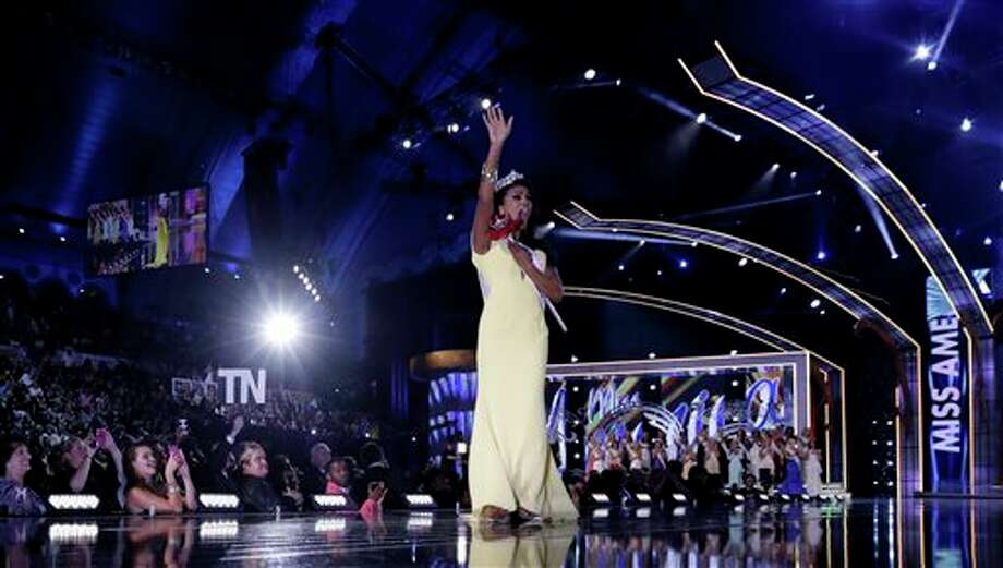 Miss New York Nina Davuluri walks on the runway after being crowned as Miss America 2014. Photo: Julio Cortez, AP / AP