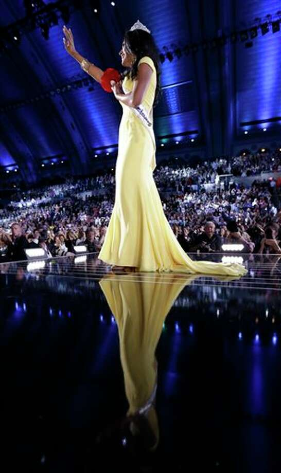 Miss New York Nina Davuluri walks on the runway after being crowned as Miss America 2014. Photo: Julio Cortez, AP / AP