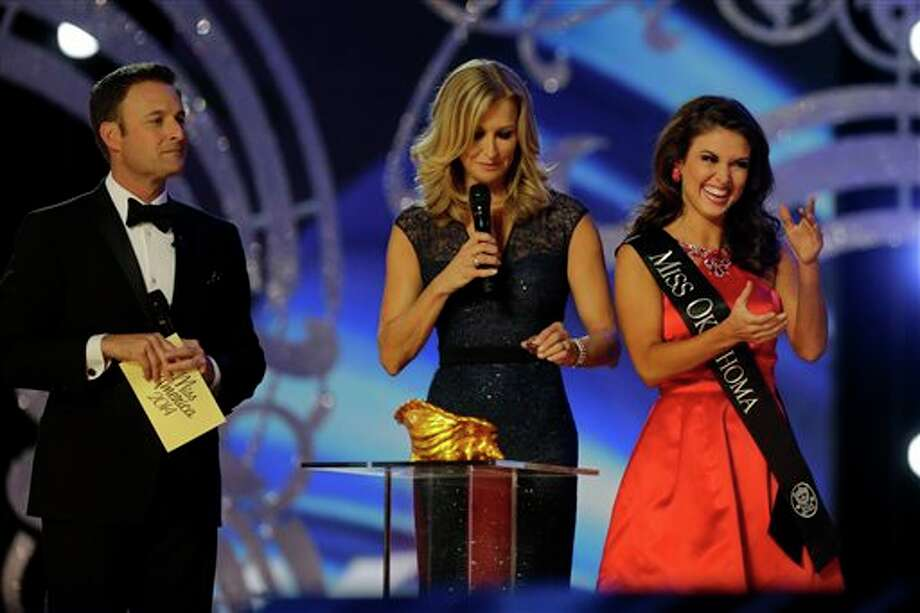 Miss Oklahoma Kelsey Griswold, right, reacts before answering a question during the Miss America 2014 pageant. Photo: Mel Evans, AP / AP