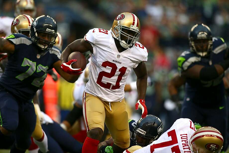 SEATTLE - SEPTEMBER 15:  Frank Gore #21 of the San Francisco 49ers runs the ball against the Seattle Seahawks on September 15, 2013 at Century Link Field in Seattle, Washington.  (Photo by Jonathan Ferrey/Getty Images) Photo: Jonathan Ferrey, Getty Images