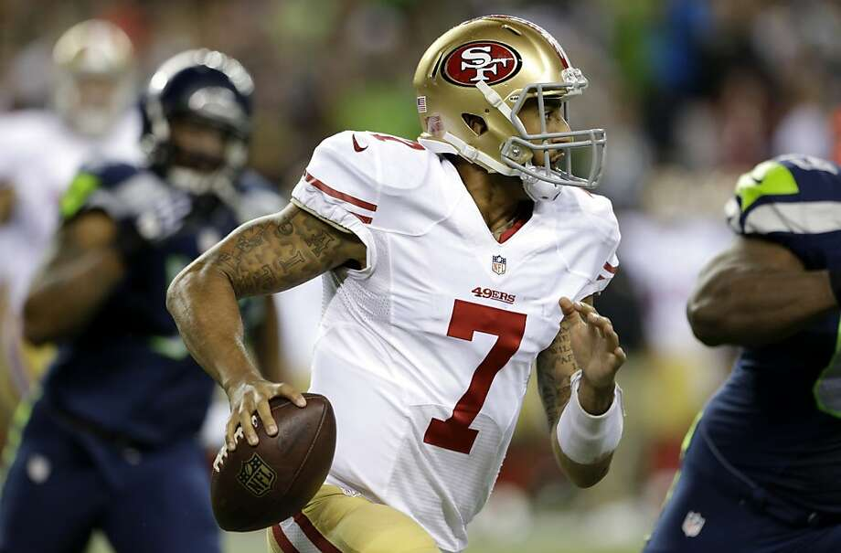 San Francisco 49ers quarterback Colin Kaepernick looks to pass in the first half of an NFL football game against the Seattle Seahawks, Sunday, Sept. 15, 2013, in Seattle. (AP Photo/Elaine Thompson) Photo: Elaine Thompson, Associated Press