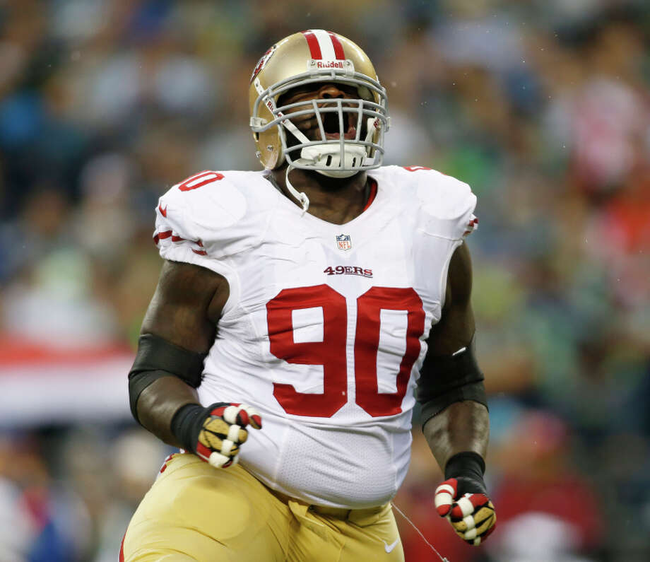 San Francisco 49ers' defensive end Glenn Dorsey celebrates a tackle during the first half of an NFL football game against the Seattle Seahawks, Sunday, Sept. 15, 2013, in Seattle. (AP Photo/John Froschauer) Photo: John Froschauer / Associated Press / FR74207 AP