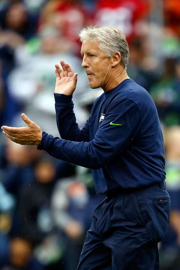 Head coach Pete Carroll of the Seattle Seahawks claps prior to their game at Qwest Field on September 15, 2013 in Seattle. Photo: Otto Greule Jr, Getty Images