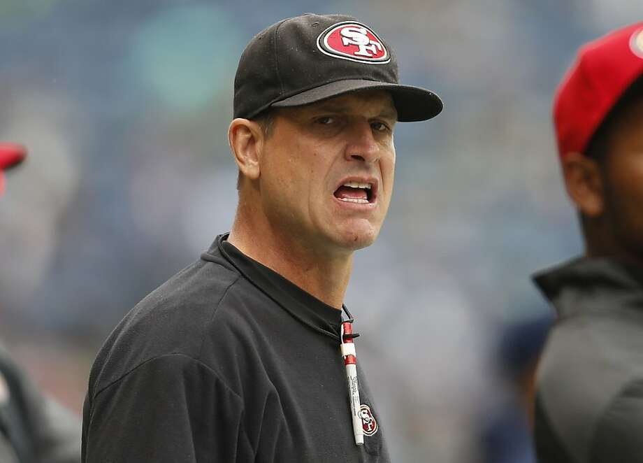 San Francisco 49ers head coach Jim Harbaugh calls to his team on the sideline before the start of an NFL football game against the Seattle Seahawks, Sunday, Sept. 15, 2013, in Seattle. (AP Photo/John Froschauer) Photo: John Froschauer, Associated Press