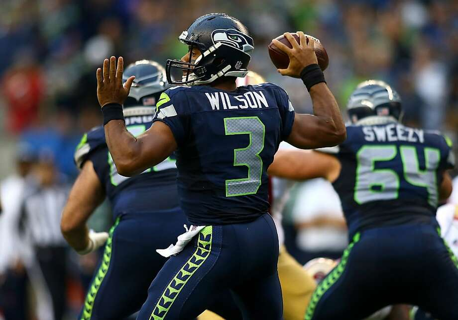 SEATTLE - SEPTEMBER 15:  Quarterback Russell Wislon #3 of the Seattle Seahawks throws against the San Francisco 49ers on September 15, 2013 at Century Link Field in Seattle, Washington.  (Photo by Jonathan Ferrey/Getty Images) Photo: Jonathan Ferrey, Getty Images
