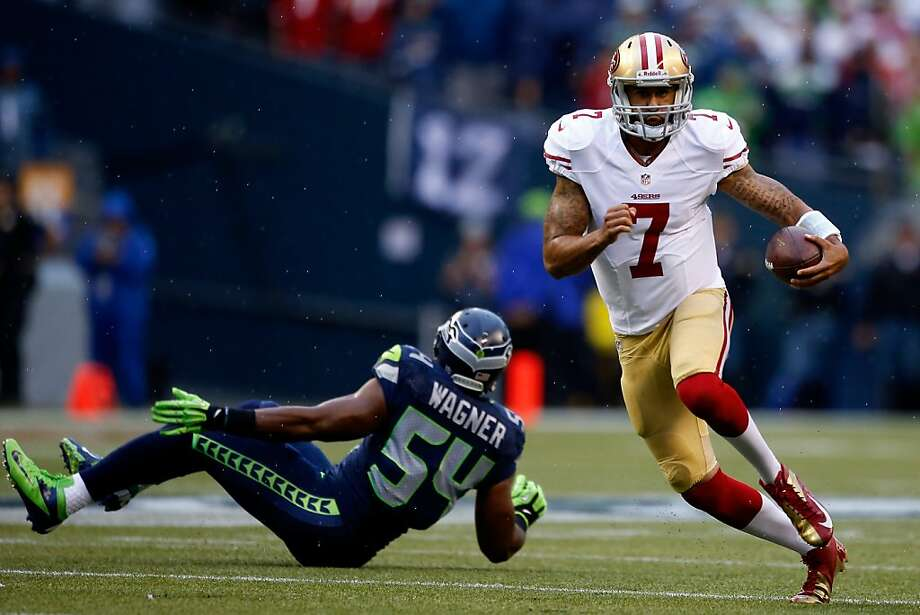 SEATTLE, WA - SEPTEMBER 15:  Colin Kaepernick #7 of the San Francisco 49ers runs the ball against Bobby Wagner #54 of the Seattle Seahawks during their game at Qwest Field on September 15, 2013 in Seattle, Washington.  (Photo by Otto Greule Jr/Getty Images) Photo: Otto Greule Jr, Getty Images