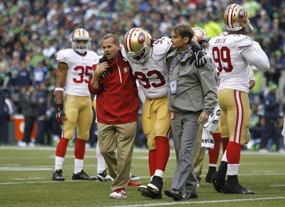 San Francisco 49ers' Ian Williams (93) is taken off the field with an injury in the first half of an NFL football game against the Seattle Seahawks, Sunday, Sept. 15, 2013, in Seattle. (AP Photo/John Froschauer) Photo: John Froschauer, Associated Press