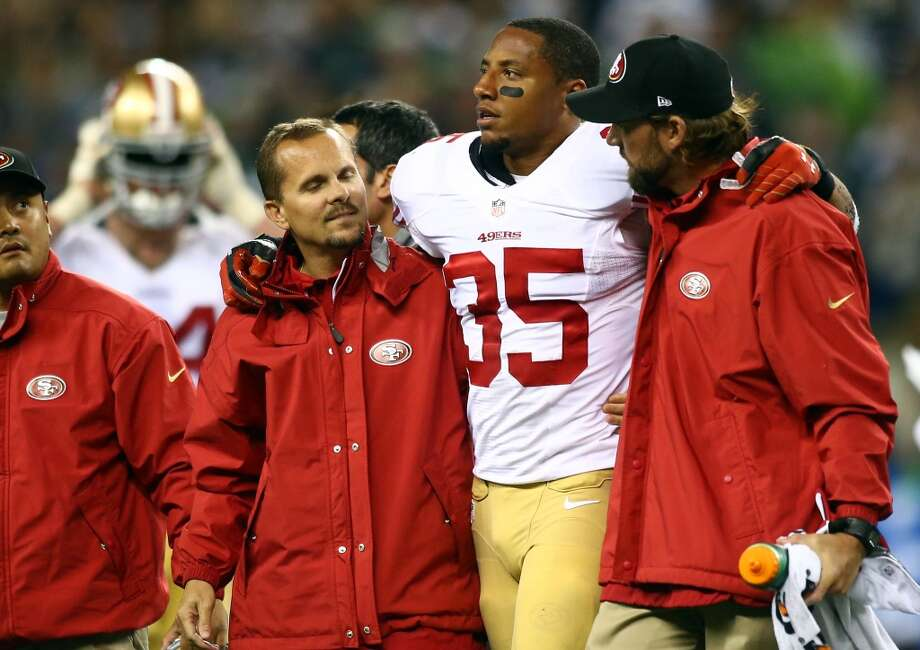 Eric Reid of the San Francisco 49ers gets helped off the field after a play against the Seattle Seahawks during their game at Qwest Field on September 15, 2013 in Seattle, Washington. Photo: Jonathan Ferrey, Getty Images