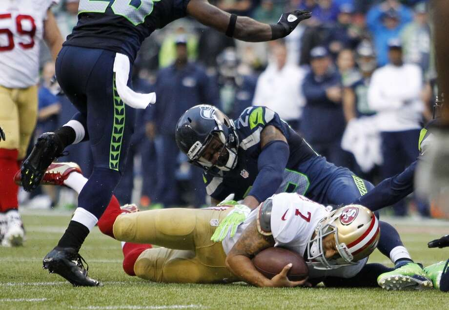 San Francisco 49ers quarterback Colin Kaepernick is sacked by Seattle Seahawks free safety Earl Thomas in the first half of an NFL football game, Sunday, Sept. 15, 2013, in Seattle. Photo: John Froschauer, Associated Press