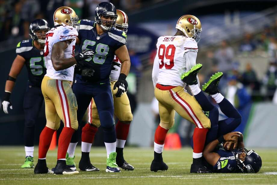 Aldon Smith #99 of the San Francisco 49ers sacks Russell Wilson #3 of the Seattle Seahawks during their game at CenturyLink Field on September 15, 2013 in Seattle, Washington. Photo: Jonathan Ferrey, Getty Images