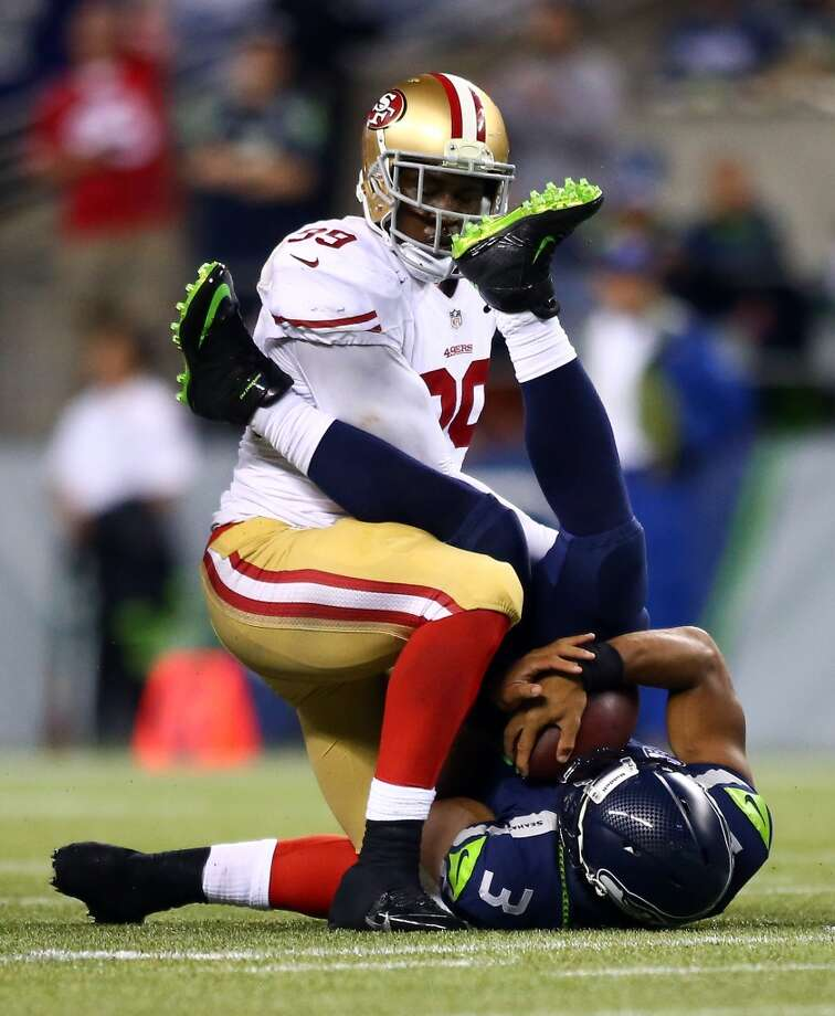 Aldon Smith #99 of the San Francisco 49ers sacks Russell Wilson #3 of the Seattle Seahawks. Photo: Jonathan Ferrey, Getty Images