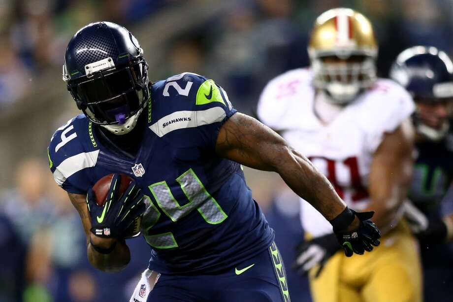 Marshawn Lynch of the Seattle Seahawks runs the ball against the San Francisco 49ers in the first half. Photo: Jonathan Ferrey, Getty Images