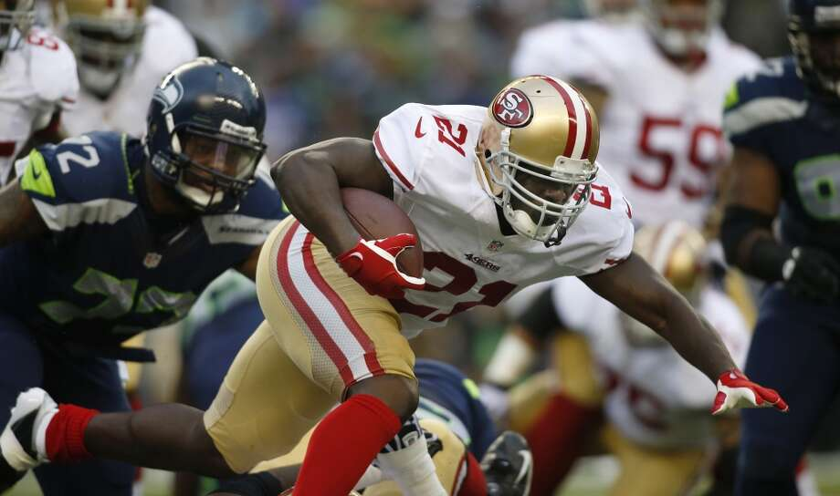 San Francisco 49ers running back Frank Gore rushes with the ball in the first half of an NFL football game against the Seattle Seahawks, Sunday, Sept. 15, 2013, in Seattle. Photo: John Froschauer, Associated Press