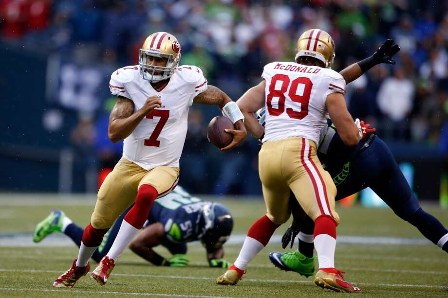 Colin Kaepernick runs the ball against the Seattle Seahawks during the first quarter. Photo: Otto Greule Jr, Getty Images
