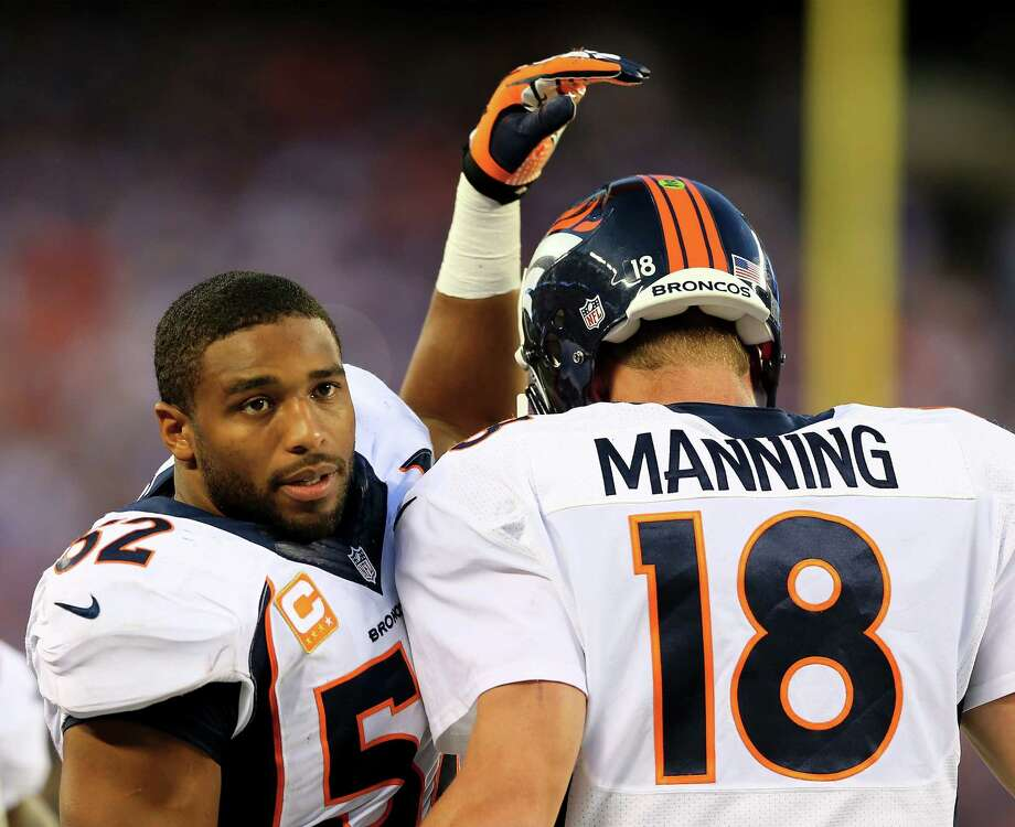 Denver's Wesley Woodyard congratulates Peyton Manning after a third-quarter score. Manning passed for 307 yards and two TDs, while brother Eli threw four picks for the Giants after tossing three last week. Photo: Elsa / Getty Images
