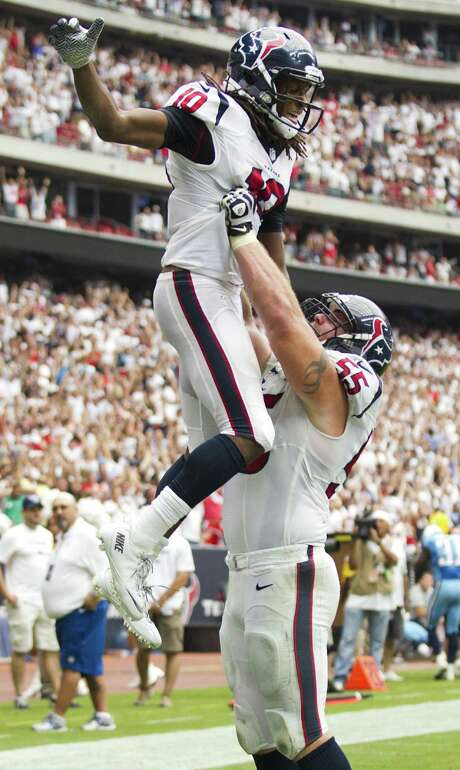 Texans receiver DeAndre Hopkins (left) exults with Chris Myers after his game-winning catch. Photo: Brett Coomer / Houston Chronicle