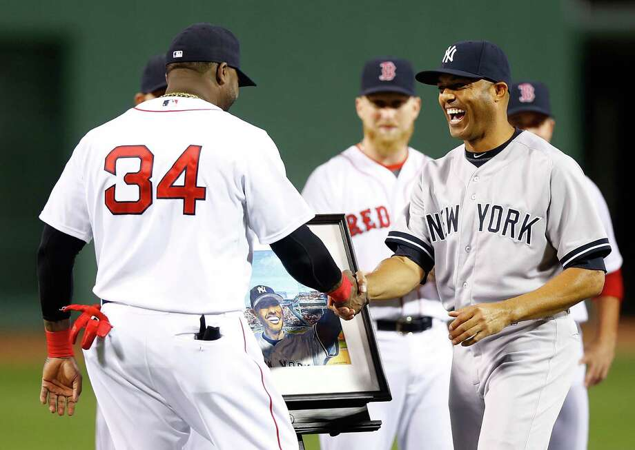 BOSTON, MA - SEPTEMBER 15: Mariano Rivera #42 of the New York Yankees is presented with a painting by David Ortiz #34 of the Boston Red Sox while being honored prior to the game against the Boston Red Sox on September 15, 2013 at Fenway Park in Boston, Massachusetts. Tonight will be Rivera's final appearance at Fenway Park as he is set to retire at the end of this season. (Photo by Jared Wickerham/Getty Images) ORG XMIT: 163495553 Photo: Jared Wickerham / 2013 Getty Images
