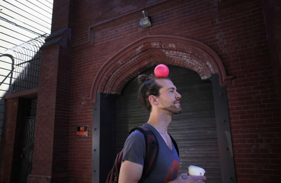 Professional contact juggler Richard Hartnell heads to Dolores Park to practices his technique in San Francisco, Calif. Photo: The Chronicle