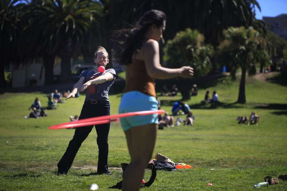 Professional contact juggler Richard Hartnell practices his technique in Dolores Park in San Francisco, Calif. Photo: The Chronicle